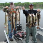 Two men with a great catch of Northern Pike and Walleye.